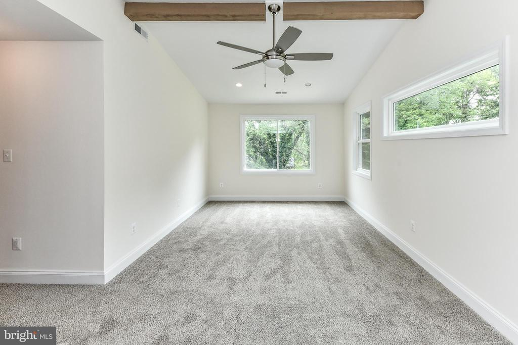 Large windows flood this master bedroom with light - 5201 MOUNT VERNON MEMORIAL HWY, ALEXANDRIA