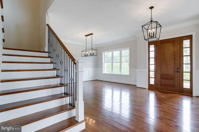 Wide stairway with metal balusters. - 2054 ARCH DR, FALLS CHURCH