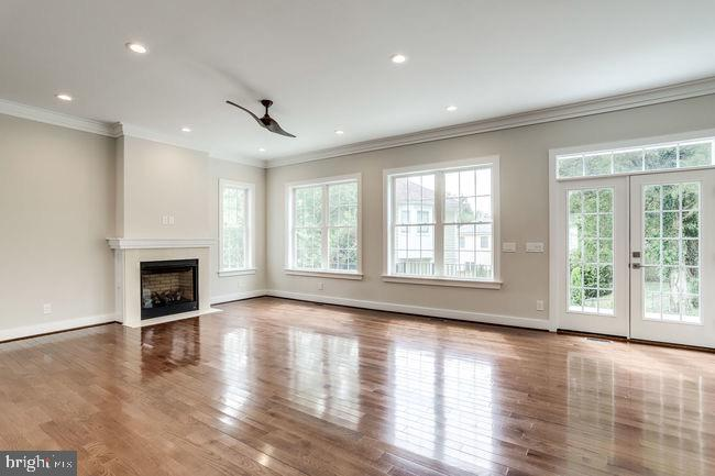 Cozy fireplace in family room with French doors. - 2054 ARCH DR, FALLS CHURCH