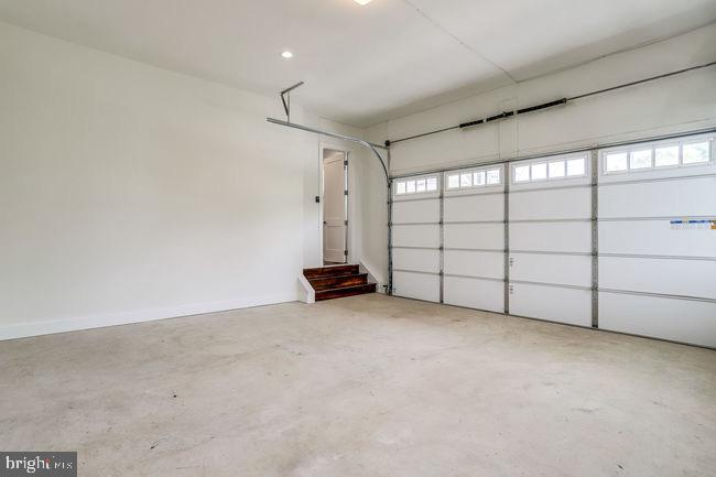 Two-car garage interior garage doors view. - 2054 ARCH DR, FALLS CHURCH