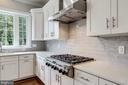 Six-burner hooded range. - 2054 ARCH DR, FALLS CHURCH