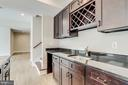 Wet bar w/ built-in wine racks & cabinet storage. - 2054 ARCH DR, FALLS CHURCH