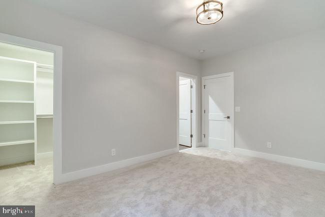 Master bedroom showing walk-in closet. - 2054 ARCH DR, FALLS CHURCH