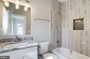 Full bathroom with ceramic tile. - 2054 ARCH DR, FALLS CHURCH