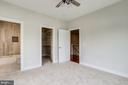 Bedroom with bathroom and walk-in closet. - 2054 ARCH DR, FALLS CHURCH
