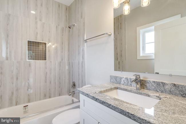 Bedroom bathroom with ceramic tile. - 2054 ARCH DR, FALLS CHURCH