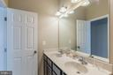 Full bath with double sinks - 17985 WOODS VIEW DR, DUMFRIES