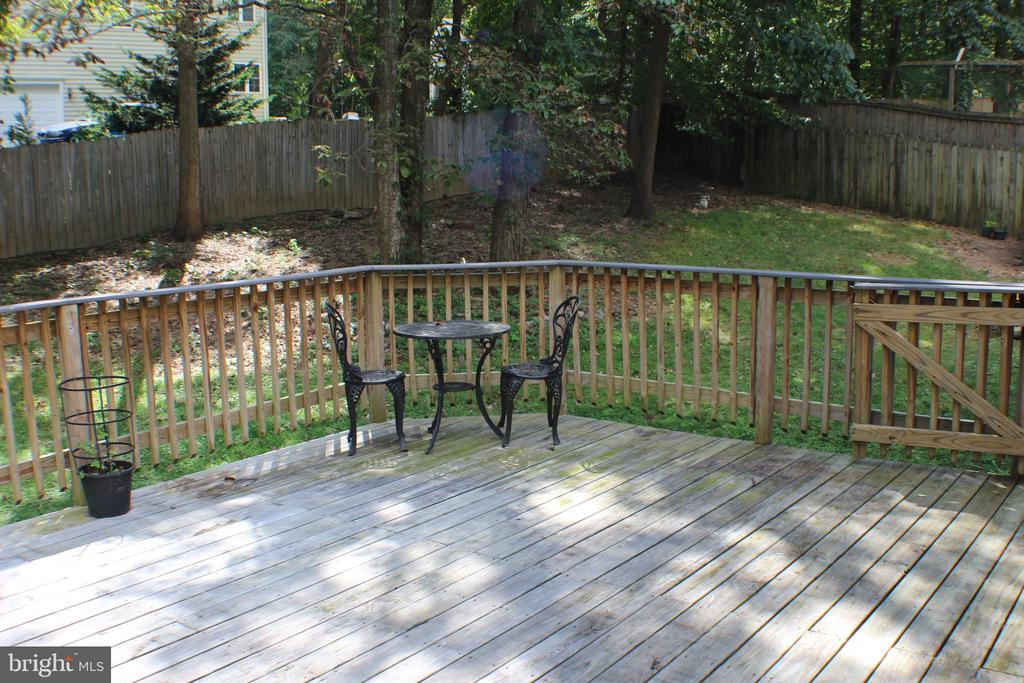 Large Back Deck and view of fenced in yard - 7738 TALBOT RUN RD, MOUNT AIRY
