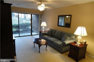 Living room, furnished - 11220 CHESTNUT GROVE SQ #124, RESTON