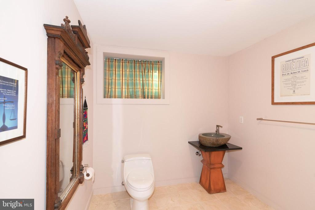 Half bath in lower level - 74 WOODCUTTERS LN, HARPERS FERRY