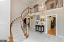 Curved wood staircase in two story foyer - 2815 N LEXINGTON ST, ARLINGTON