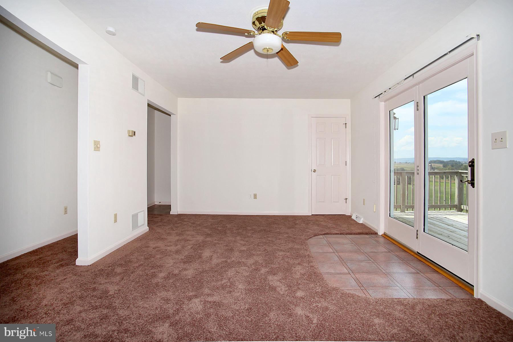 Family Room with access to deck & great view.