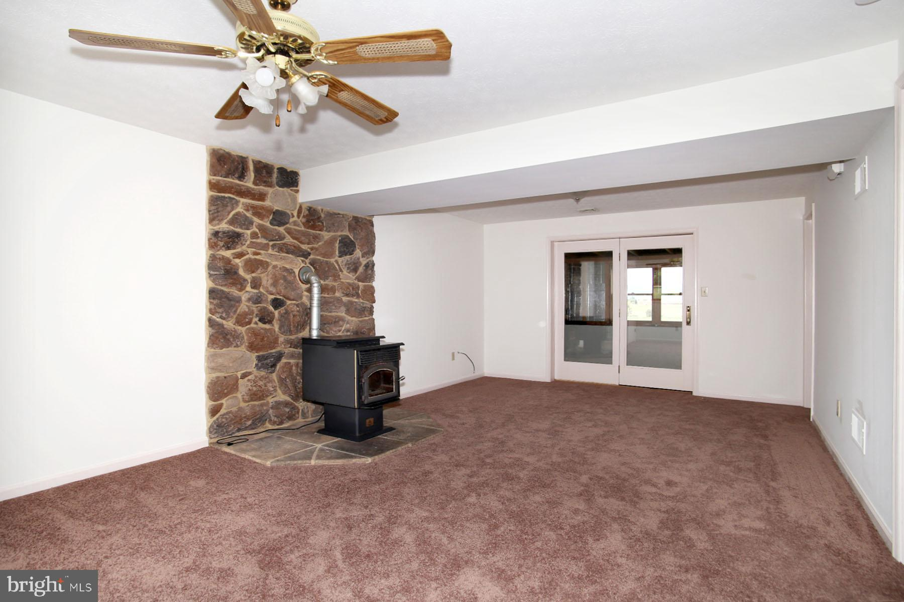 Rec. Room/Bonus Room with pellet stove.