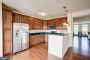 Kitchen opens to living/dining space - 43526 STONECLIFF TER, CHANTILLY