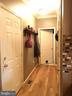 Kitchen hallway to garage, 1/2 bath, 2 pantries - 9355 DEVILBISS BRIDGE RD, WALKERSVILLE