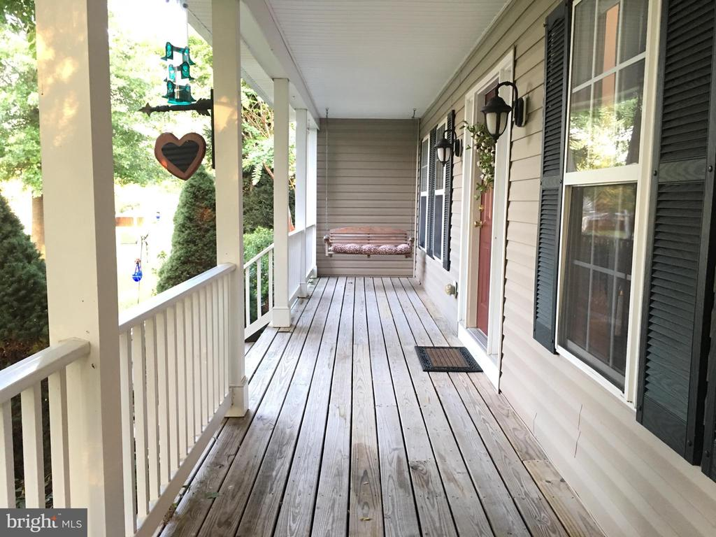 large front porch with swing - 9355 DEVILBISS BRIDGE RD, WALKERSVILLE
