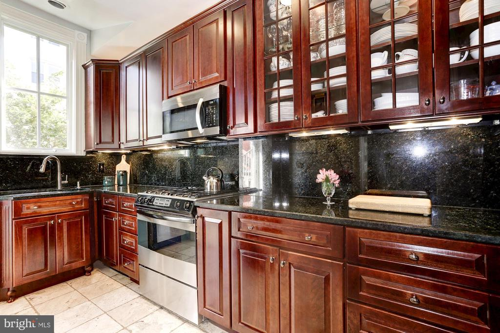 Kitchen with stainless steel appliances - 1612 RIGGS PL NW, WASHINGTON
