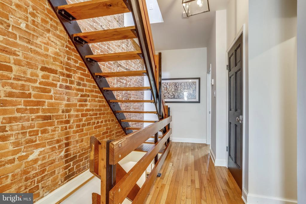Exposed brick and open staircase - 1409 COLUMBIA ST NW, WASHINGTON