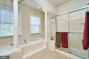 Adjoining master bath with separate tub and shower - 10828 HENRY ABBOTT RD, BRISTOW