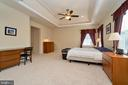 Master bedroom with tray ceiling with uplight - 10828 HENRY ABBOTT RD, BRISTOW