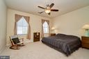 Bedroom with lighted ceiling fan - 10828 HENRY ABBOTT RD, BRISTOW