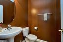 Main level powder room with pedestal sink - 10828 HENRY ABBOTT RD, BRISTOW