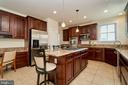 Gourmet kitchen with large center island - 10828 HENRY ABBOTT RD, BRISTOW