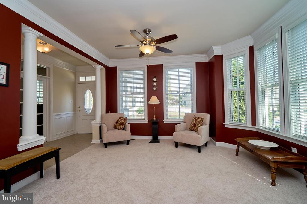 Formal living room with new carpet and ceiling fan - 10828 HENRY ABBOTT RD, BRISTOW