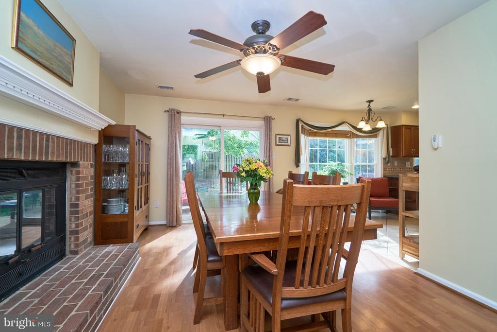 Family room w/hardwood flooring & a gas fireplace - 14515 WILLIAM CARR LN, CENTREVILLE