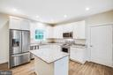 Kitchen with Granite Countertops and Hardwood - 210 FAIRFAX LN, LOCUST GROVE