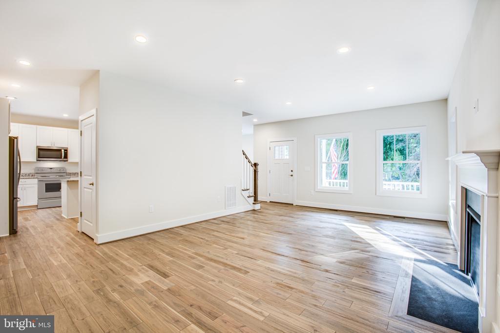 Living Room with Gas Fireplace - 210 FAIRFAX LN, LOCUST GROVE