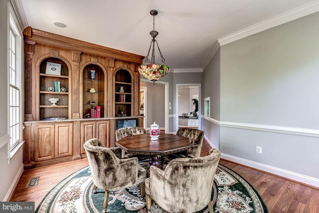 Library with Custom Cabinetry & Wine Fridge - 43546 FIRESTONE PL, LEESBURG