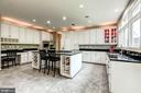 Kitchen with porcelain tile - 43546 FIRESTONE PL, LEESBURG