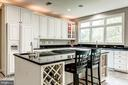 Large Island w/cooktop & space for seating - 43546 FIRESTONE PL, LEESBURG