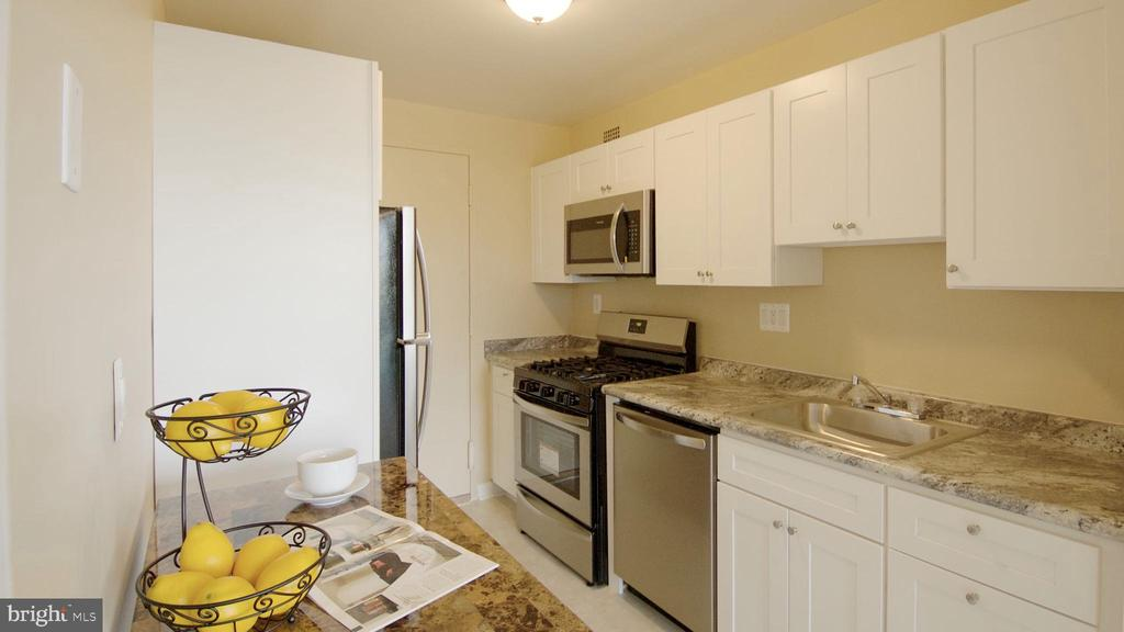 Kitchen with Service Entrance and Gas Cooking - 10201 GROSVENOR PL #818, NORTH BETHESDA