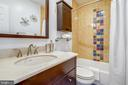 Mediterranean-style tiled Full bath upstairs. - 718 F ST NE, WASHINGTON