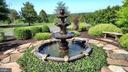 Cascading fountain decor in a circular driveway - 120 QUAIL LN, NEW MARKET