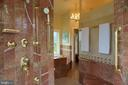 Large walk-in shower circled by glass block - 120 QUAIL LN, NEW MARKET