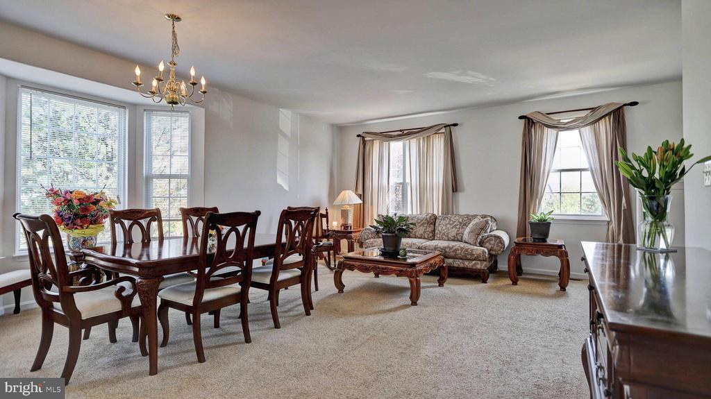 Open and sun filled dining room and living room - 44148 APPALACHIAN VISTA TER, ASHBURN