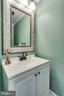 Updated half bath with beautiful designer mirror - 6411 WYNGATE DR, SPRINGFIELD