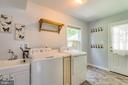 Laundry/mud room with tiled floor, carport entry - 6411 WYNGATE DR, SPRINGFIELD