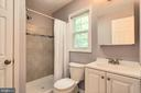 Updated master bath with tile flooring - 6411 WYNGATE DR, SPRINGFIELD