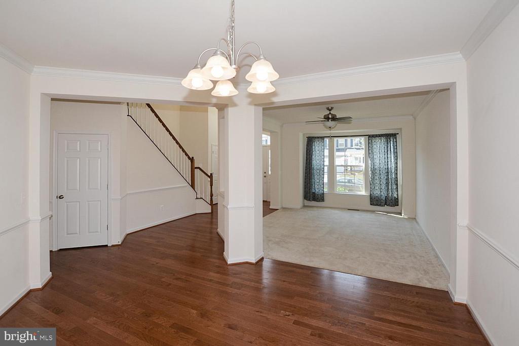 Dining room with hardwood floors - 10306 SPRING IRIS DR, BRISTOW