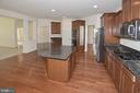 Kitchen with large island and 5 burner gas cooktop - 10306 SPRING IRIS DR, BRISTOW