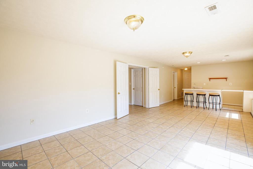 Lower level offers sunny rec room with bar - 92 BRUSH EVERARD CT, STAFFORD
