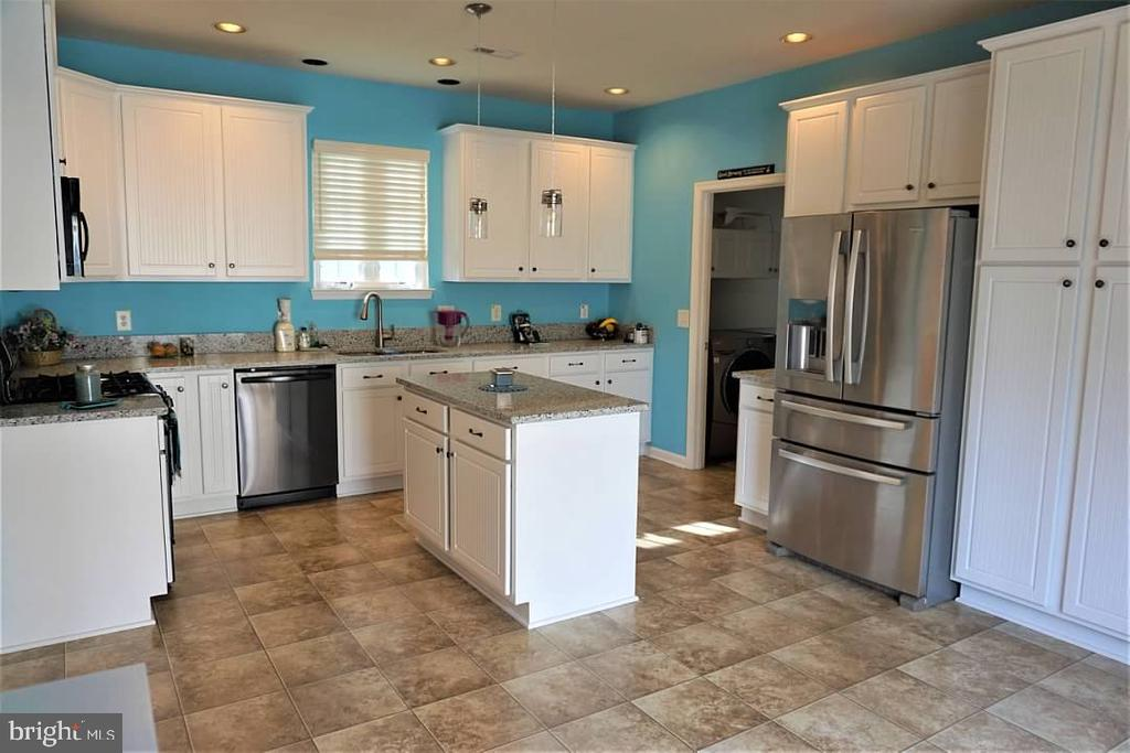 Remodeled kitchen features quartz counter tops. - 6205 HAWSER DR, KING GEORGE