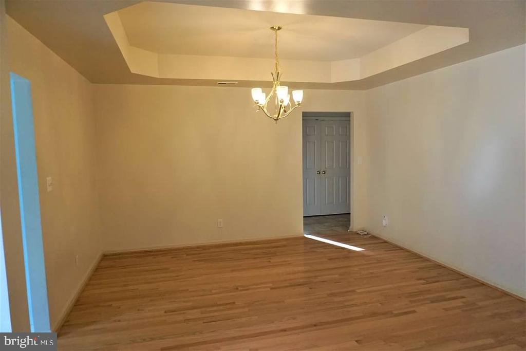 Large dining room with tray ceiling. - 6205 HAWSER DR, KING GEORGE