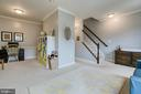Living room/dining room (with chair rail molding) - 10864 DEPOT DR, BEALETON