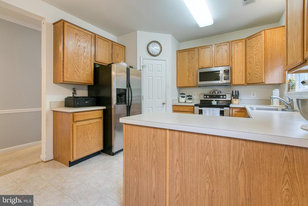 Kitchen with stainless steal appliances - 10864 DEPOT DR, BEALETON