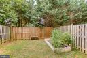 Fenced back yard with raised bed for gardening - 10864 DEPOT DR, BEALETON